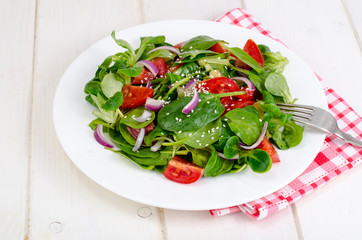 Concept of weight loss, healthy lifestyle. Light salad from fresh vegetables and herbs