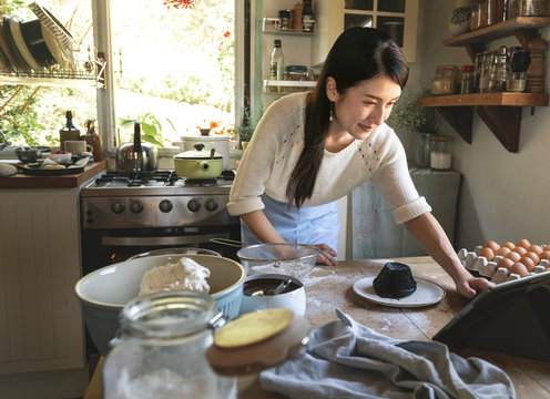 Japanese woman making a Chocolate lava cake