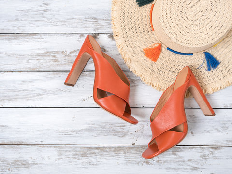 Womens accessories,  footwear  (straw hat, open toe criss cross leather mule heels shoes). Fashion outfit, spring summer collection. Shopping concept. Flat lay, view from above