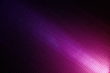 On a purple background in the point the diagonal bright beam of light