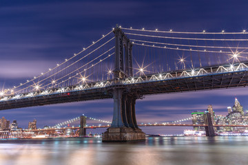 View on Manhattan Bridge at night from east river with long exposure