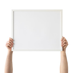 Holding frame mockup. Photo Mockup. Man hands hold frame. For frames and posters design. Frame size 20x16 (50x40cm).