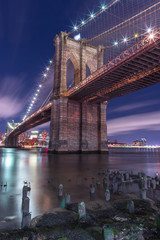 View on Brooklyn bridge from east river at night with long exposure
