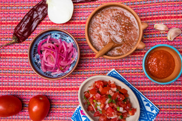 Table Top Spread of Traditional Salsas and Condiments in Mexico
