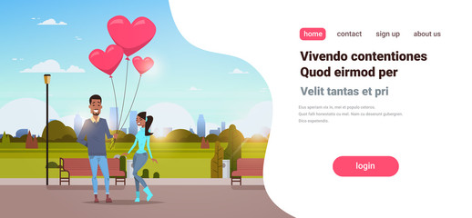 man giving woman pink heart shape air balloons happy valentines day concept african american couple in love city urban park cityscape background horizontal copy space