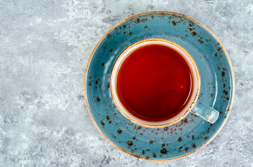 Hot tea in blue cup and saucer