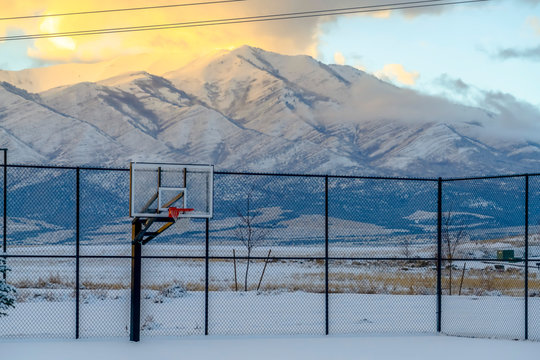 Basketball court and mountain covered with snow
