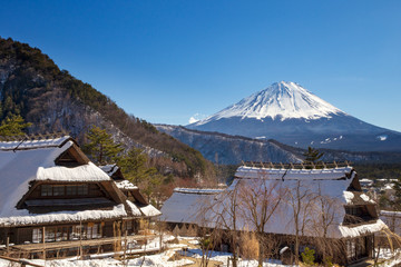 Mont Fuji on a clear winter day, from Saiko village covered by pristine snow in the five lakes region.