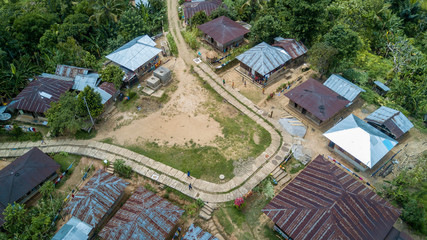 Drone shot aerial central place of a very small simple mountain village in the jungle mountains of Flores - Indonesia