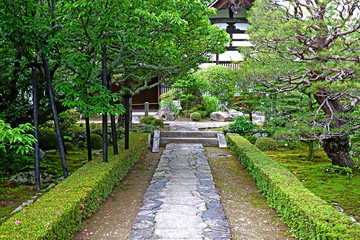 Japan traditional zen garden, stone road, green plants
