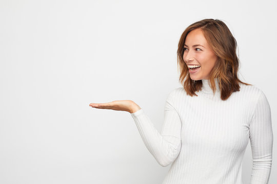 young happy woman presenting your product