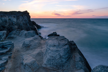 French landscape - Bretagne. A beautiful coast with rocks at sunset.