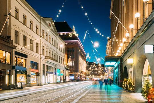 Helsinki, Finland. Night View Of Aleksanterinkatu Street With Railroad In Kluuvi District In Evening Christmas Xmas New Year Festive Illumination