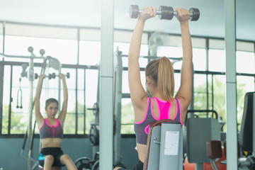 fitness woman doing exercises and warm up at gym ; healthy lifestyle