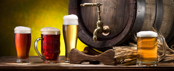 Wall Mural - Glasses of beer and beer cask on the wooden table. Craft brewery.