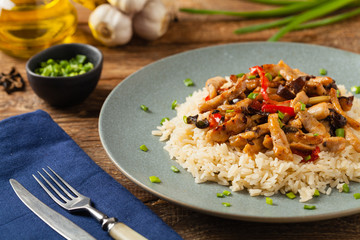 Pork chop with peppers, mushrooms and bamboo. Served with rice.