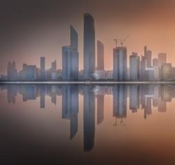 Cityscape of Abu Dhabi Skyline at misty sunrise, UAE