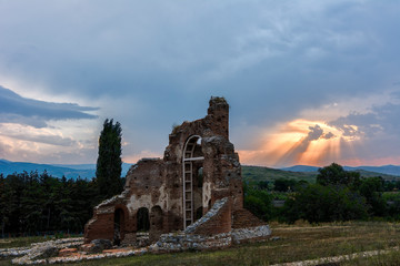 sunset over red church in bulgaria