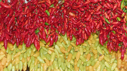 Full frame shot of red and yellow chili peppers