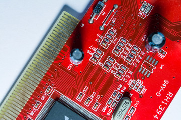 Texture or background. Red color the motherboard from the computer. Memory card. Repair. Workshop. Repair of electronics.