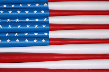 flag of usa on baseball bats on wall. Texture, background