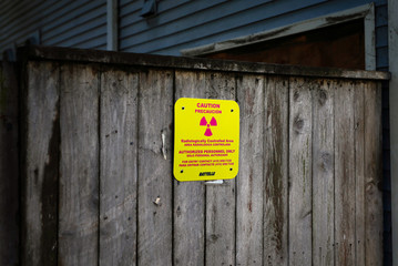 A caution sign with a radioactive symbol on it is seen on a condemned building on Treasure Island, near San Francisco