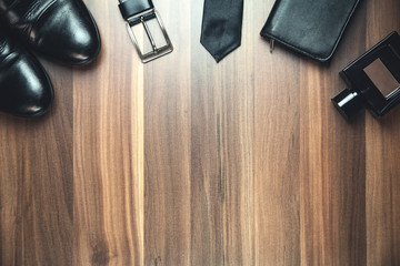 Men's accessories on the wood background.