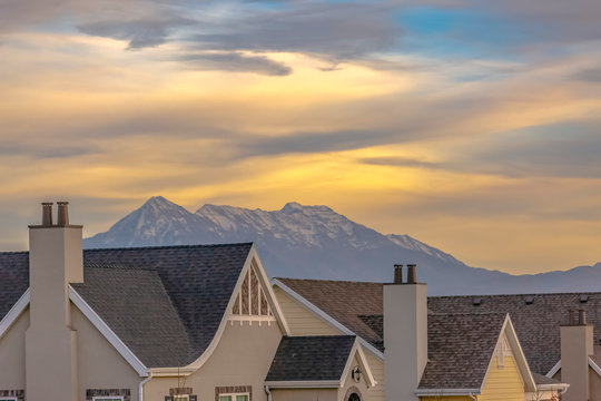 Roof of homes against mountain and sky in Utah
