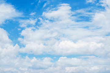 soft white clouds in the blue sky background