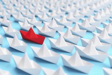 Viele Origami Schiffe als Individualität Konzept