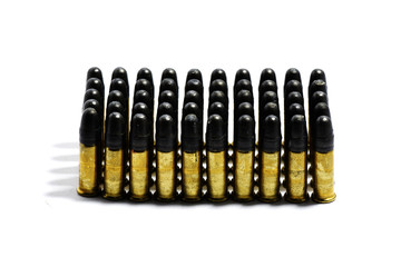 Gun with ammunition on white background.