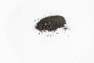 Charcoal powder (activated carbon) on white background.