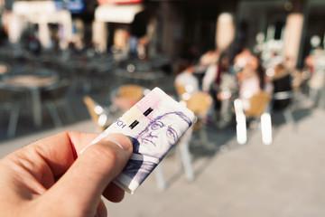 man paying the bill with czech korunas
