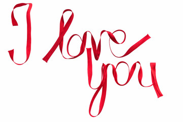 """Phrase """"i love you"""" written with red silk ribbon"""