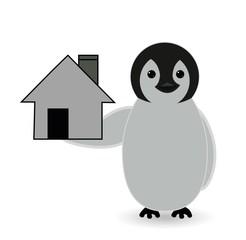 penguin standing near house