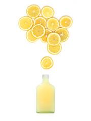 bottle with fresh lemon juice is standing under many lemon slices on white background