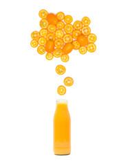 bottle with fresh kumquat juice is standing under many kumquat slices on white background