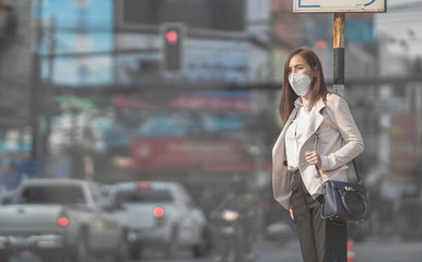 Asian woman are going to work.she wears N95 mask.Prevent PM2.5 dust