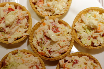 home made pintxos with crab meat and eggs and mayones sause in tartlet, traditional spanish snack