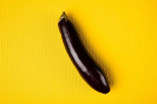Abstract eggplant on yellow background
