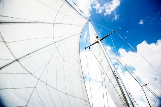 Close-up view of the mast and sails against cloudy blue sky. Baltic sea, Estonia