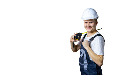 Builder in helmet with tape measure. Measuring device for construction. Construction concept