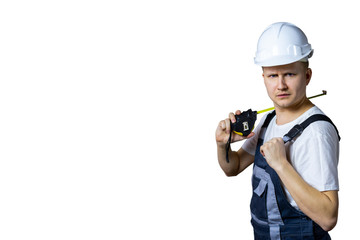 A construction worker with a measuring tape is surprised at what is happening. Builder in a helmet with a tape measure. Construction concept