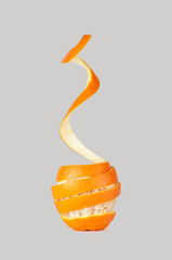 orange peel coiled, peeled orange, orange peeled, on a gray background