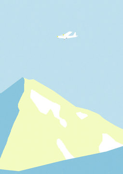 Airplane flying over mountain