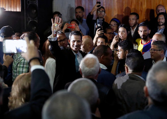 Venezuelan opposition leader and self-proclaimed interim president Juan Guaido attends a meeting with supporters to present a government plan of the opposition in Caracas