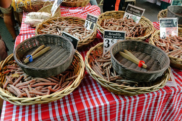 Small sausages at local market in Arles, France