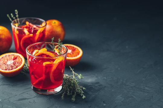 Red orange juice in a large glass or aperitif with campari