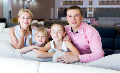 Family which is choosing new sofa