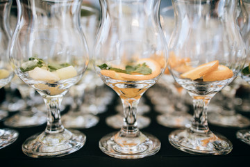 Many glasses for drinks on the wedding table